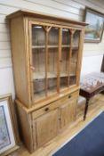 A Victorian pine glazed cabinet, width 118cm, depth 40cm, height 194cm
