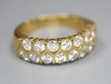 A modern 18ct gold and fifteen stone two row diamond set half hoop ring, size O, gross 6.6 grams.