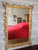 A rectangular gilt frame wall mirror, width 75cm, height 110cm