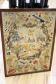 An early 19th century needlepoint, the central cartouche of an oriental scene surrounded by flowers,