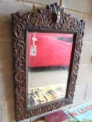 A late Victorian carved oak mirror, 60 x 90cm together with a late Victorian carved oak rope-twist