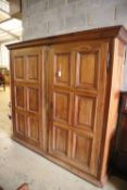 A 19th century French walnut two door panelled armoire, width 224cm, depth 58cm, height 222cm