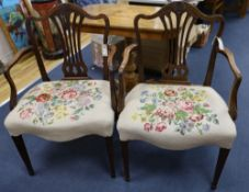 A pair of Hepplewhite style mahogany open armchairsCONDITION: One slightly lighter than the other.