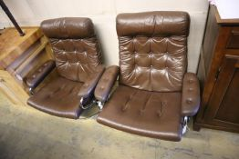 A pair of Erkones brown leather and chrome reclining armchairs