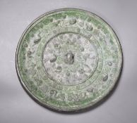 A bronze Chinese squirrel and grape pattern mirror, Tang dynasty or later, diameter 24cm