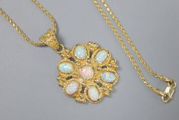 A Turkish 585 and white opal flowerhead pendant on chain by Istor, the pendant set with seven