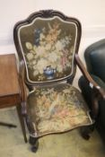 A Victorian rosewood scroll armchair