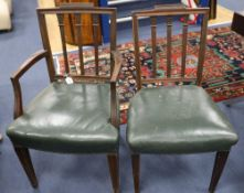 A set of six Hepplewhite style mahogany chairs (two with arms)