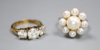 A modern 18ct white gold and cultured pearl cluster ring, size L/M, gross 7 grams and a paste set