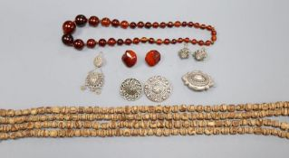 Assorted jewellery including necklaces and white metal brooches.