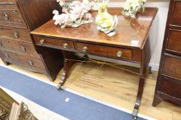 A Regency satinwood banded mahogany sofa table, with two ebony beaded drawers, on ebony strung