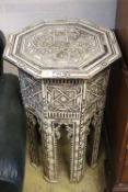 A Middle Eastern octagonal topped ebony and bone inlaid coffee table (damaged), width 49cm, 81cm