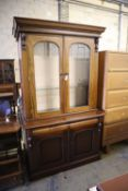 A pair of Victorian style mahogany bookcases, width 125cm, depth 50cm, height 218cm