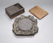 A 19th century Chinese black slate inkstone and another with wood base and cover