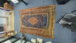 A Shiraz blue ground carpet, 305 x 214cm