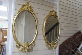 A pair of Victorian giltwood and gesso girandoles, width 46cm, height 80cm