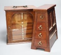 A Victorian mahogany coin collector's cabinet, 27cm wide, and a mahogany table top bank of four