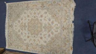 A Persian ivory ground part silk rug, 210 x 150cm