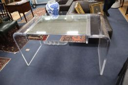 A 1970s Lucite desk with part mirrored top, width 130cm, depth 60cm, height 73cm