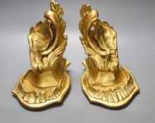 A pair of carved giltwood wall brackets, carved in rococo style, height 23cm