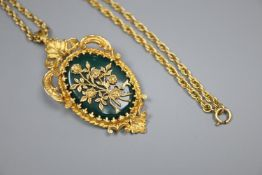 A 1970's 9ct gold and chrysophase set oval flower and scroll pendant brooch, on a multi-link 9ct