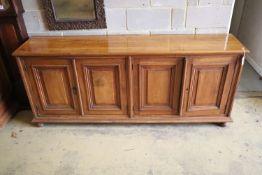 A 19th century French walnut four door panelled cupboard, width 210cm, depth 46cm, height 87cm