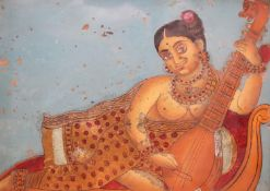 19th century Indian School, reverse painted and gilt glass, Woman playing a sitar, 25 x 30cm