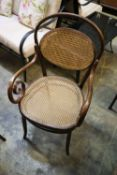 An early 20th century caned bentwood elbow chair