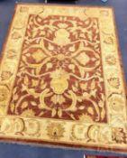 A Zeigler style burgundy ground carpet, 400 x 300cm