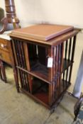 A late Victorian mahogany revolving bookcase, width 52cm, depth 52cm, height 84cm