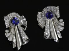 A pair of diamond and synthetic sapphire clips in white metal settings (tests as platinum), white
