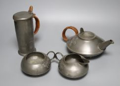 A Liberty's Tudric pewter three piece tea set, shape no.0231 and a Liberty's Tudric pewter