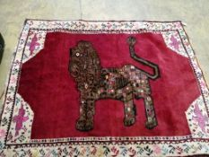 A North West Persian red ground 'Lion' rug, 176 x 142cm