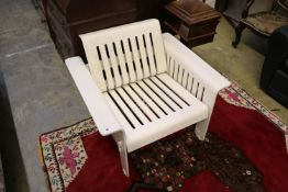A 1960's white plastic armchair, with slatted slides