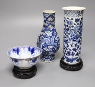 A Chinese blue and white vase with four-character mark, a similar cylindrical vase and a small bowl,