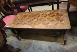 A Victorian walnut parquetry topped occasional table, width 50cm, depth 102cm, height 47cm