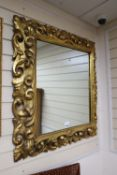 A 19th century carved Neapolitan style wall mirror, width 84cm, height 94cm