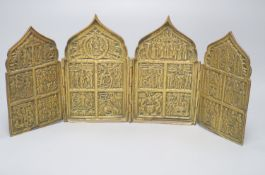 An early 19th century Russian four-section cast brass travelling icon, each panel having ogee arched