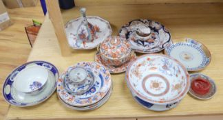 A collection of mixed Chinese and Japanese ceramics, mostly damaged