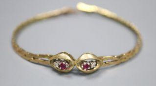 A modern 9ct, two stone ruby and two stone diamond set bracelet, 18cm, gross 8.2 grams.
