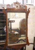 A George III style mahogany fret frame wall mirror, width 52cm, 93cm high