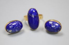 A Middle Eastern yellow metal and lapis lazuli oval dress ring, size N, and pair of matching