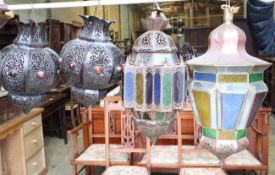 A Moroccan copper and stained glass octagonal hanging lantern and a pair of pierced bronzed metal