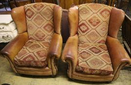 A pair of Tetrad style leather and kelim fabric upholstered wing club armchairs