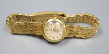 A lady's 1960's Omega Ladymatic wrist watch, on an 18ct gold bracelet with expanding clasp, gross
