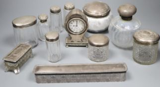 An Edwardian silver mounted balloon shaped timepiece, 11.5cm and sundry mounted toilet jars.