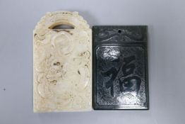 A Chinese white and russet jade 'dragon' plaque and a spinach green jade plaque, 6.2 - 7.3cm