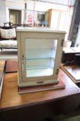An Arnold & Sons cream painted metal medicine cabinet, width 47cm, depth 29cm, height 61cm