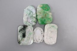 Four Chinese jadeite plaques and a similar belt plaque, 4 - 5.4cm