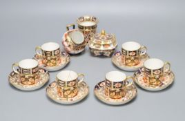 A Royal Crown Derby part tea service, pattern no. 2451, a similar vase and a sugar scuttle (faults)